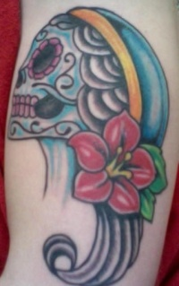 Female dia de muertos skull tattoo